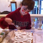 boy decorates gingerbread