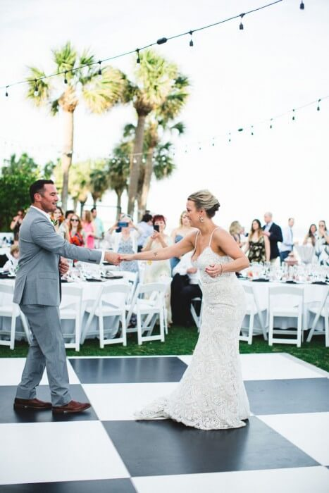 Bride and Groom Dancing Checkered Dance Floor