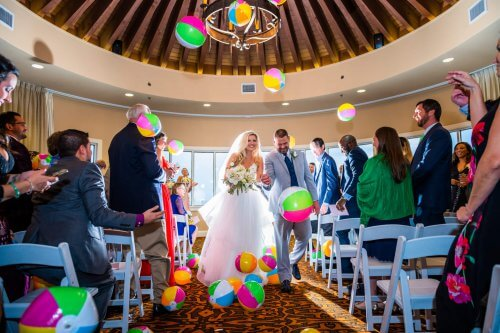Bride and Groom Exiting through Beach Balls