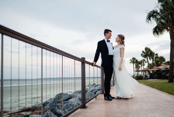 Bride and groom on oceanfront walkway