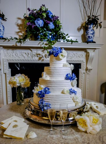 White wedding cake with blue and white flowers