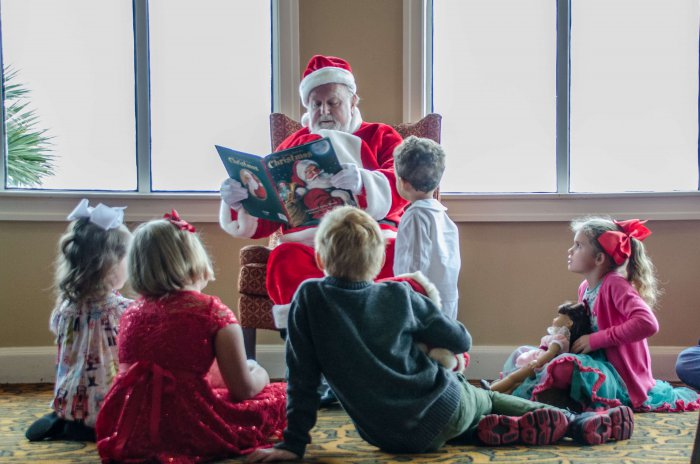 Santa reading a book at The King and Prince